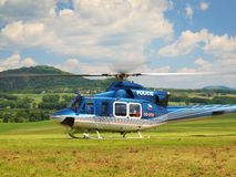 Police helicopter in action, propellers are turning and the machine is ready to fly. Blue sky in background stock images