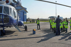 Police helicopter and children on trips Royalty Free Stock Images