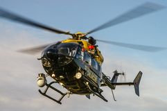 Police helicopter Eurocopter EC145 landing royalty free stock photo