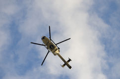 Police helicopter in the sky of Brussels during demonstration. Police helicopter flying in the sky during the TTIP GAME OVER demonstration in Brussels. A call Stock Photography