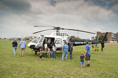 Police helicopter and visitors Royalty Free Stock Photos