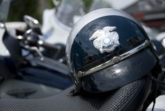 Police Helmet. An American police helmet on the saddle of a motorcycle Stock Photography