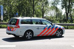 Police of highway patrol in action after collision on Motorway A20 at Nieuwerkerk aan den IJssel in the Netherlands stock image