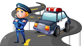A police and his patrol car in the middle of the road Stock Photos