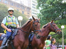 Mounted police officers in Australian metropolis. New South Wales Mounted Police on patrol in Hyde Park, Sydney, Australia. Crowd management. Street photography Stock Photo