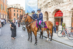Police on horses are watching and helping the spectators at the Stock Images