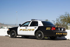 Police interceptor. A police interceptor vehicle waiting in a parking lot Stock Photo