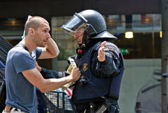Police intervention, Barcelona, Spain. Protestor discussing with catalan police officer, Mosso d`Esquadra after  being hurt at his head during massive police Stock Images