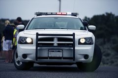 Police Intervention. Police Cruiser on the Road with Flashing Lights Royalty Free Stock Photography