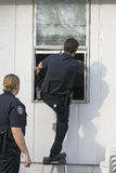 Police investigating burglary Royalty Free Stock Photo