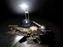 Police investigation. A light illuminates a Magnum 44 gun, a police badge, some photographies and evidence bags on a table Royalty Free Stock Photo
