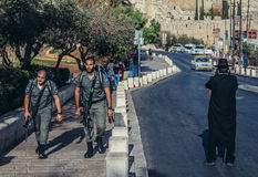 Police in Jerusalem. Jerusalem, Israel - October 22, 2015. Officers of Israeli Border Police called Magav passes next to Orthodox in Jerusalem city stock image