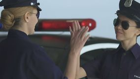 Police lady making high-five gesture trustful relations in squad gender equality. Stock footage stock video