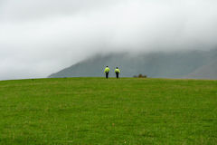 Police Lake District. Walking in the field near Keswick Royalty Free Stock Images