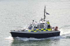 Police launch. A police launch patrolling  in Portsmouth Harbour Stock Photo