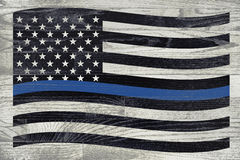 Police and Law Enforcement Flag. A police law enforcement flag with blue stripe over a white washed wooden floor royalty free stock images