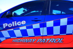 Police lettering on car door. Police and Highway Patrol lettering on colorful door of an Australian police car stock images