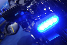 Police light. Police blue light in front of police motorbike Stock Images