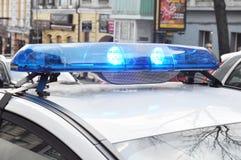 Police lights on city street. Blue light flasher at top of a police car. Police lights on street. Blue light flasher at top of a police car royalty free stock photography