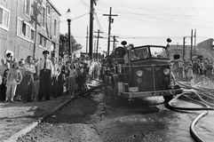 Police Line, Vintage News Photo, BC Canada. Citizens hold the line behind policemen at a Vancouver BC fire in the 1950s royalty free stock image