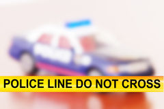Police Line. Do not cross. Over police car background Royalty Free Stock Photos