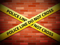 Police line background. Yellow police line tape on a brick wall Royalty Free Stock Photo