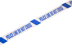 Police line crime scene tape and white copy space. Blue, angled police line do not cross crime scene tape and white copy space Stock Photography