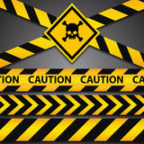 Police line and danger tapes on dark background Royalty Free Stock Photo