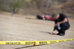 Police line do no cross with blurred law enforcement background Stock Image