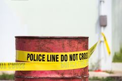 Police line do no cross with red barrel to protection crime scene. With copy space stock photos
