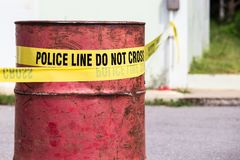 police line do no cross with red barrel to protection crime scene stock images