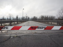 Police line, do not cross. Local Police line Polizia Municipale in Italian, do not cross. Bridge access blocked for flood risk Royalty Free Stock Photography