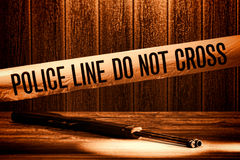 Police Line Do Not Cross Murder Crime Scene Tape. Police line do not cross safety warning tape at forensic murder crime scene with shotgun weapon shooting Royalty Free Stock Image