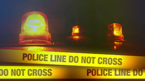 Police Line Do Not Cross Yellow Headband Tape and Orange flashing and revolving light. Murder Scene Police Ribbon. 1920x1080 full hd footage stock video footage