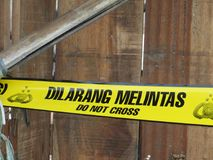 Police line in Jakarta. JAKARTA, INDONESIA - September 28, 2017: Police line, yellow tape at a crime scene Royalty Free Stock Photography
