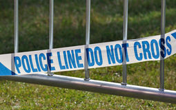 Police line tape. Police line do not cross tape, blocking off crime or accident scene Royalty Free Stock Photo