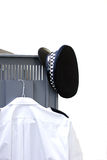 Police locker. Policemans hat and shirt hanging on a locker door Royalty Free Stock Images