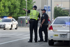 Police looking. Police attendance at the May 19th 2013 Peoria IL 1st Marathon Royalty Free Stock Photo