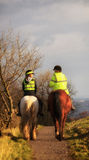 Police Lovers on horse. Shoot in Edinburgh, UK, a pair of lover was sitting on their horses at the time of sunset Royalty Free Stock Image