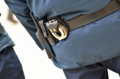 Police man from behind. Police officer with handcuffs at the back Stock Photo