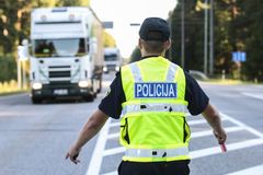Police man directing traffic. Latvian police man is directing traffic Stock Image