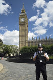 Police man in front of the Big Ben Stock Photos