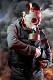 Police man with gas mask over explosion background Royalty Free Stock Image