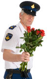 Police man with roses Royalty Free Stock Photo