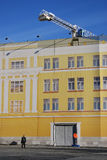 A police man stand by artificial building facade. Moscow Kremlin. Royalty Free Stock Images