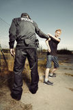 Police man taking a teenager to handcuffs Stock Photos
