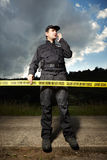 Police man in uniform on place of investigation Royalty Free Stock Image