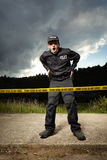 Police man in uniform on place of investigation Royalty Free Stock Images