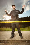 Police man in uniform on place of investigation Royalty Free Stock Photo