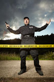 Police man in uniform on place of investigation Stock Images
